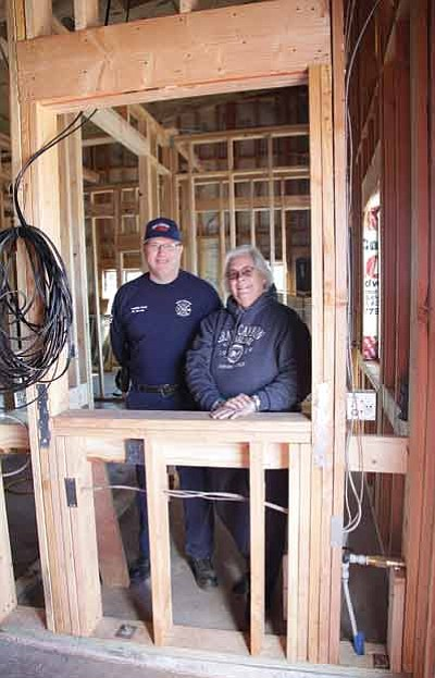 HCFR Deputy Fire Chief Robert Trotter and HCFR Board Member Patty Everts stand in what will eventually be the station's command center. Ryan Williams/WGCN