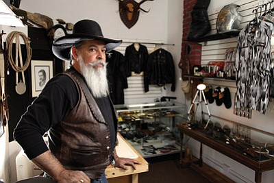 Jay Redfeather stands in Open Road Cowboy. Redfeather can often be found working on custom leather pieces in his shop on Route 66. Ryan Williams/WGCN