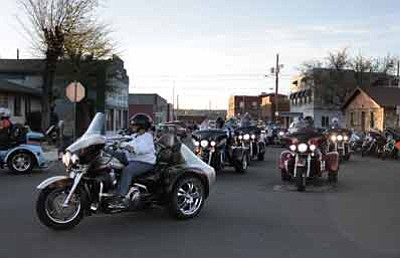 Run for the Wall riders drive down Third Street in Williams May 15. Marissa Freireich/WGCN