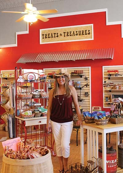 Treats N Treasures manager Linda Miller stands with some of the gifts available in the shop. Marissa Freireich/WGCN