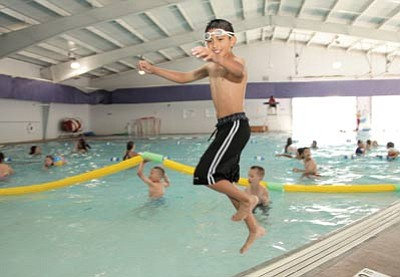 Angel Serrato jumps into the Williams Aquatic Center pool during a Williams Summer Rec pool field trip last week. Ryan Williams/WGCN