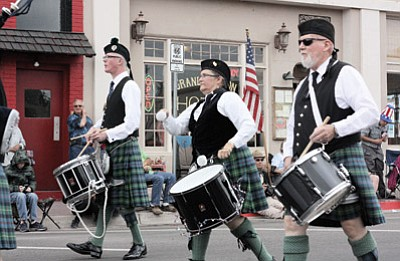 Patty Williams (center) and other members of the Southwest Skye Pipe and Drums march in last year's Williams Fourth of July parade. This year's parade begins at 11 a.m. on Route 66. Clara Beard/WGCN