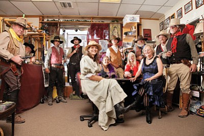 """Members of the Cataract Creek Gang are up to no good at Buck's Place in downtown Williams. Pictured: Lisa """"Miss Molly"""" Oakley, Sandy """"Miss Myra Belle"""" Wheeler, Patty """"Miss Violet"""" Williams, Jan """"Miss Sadie"""" Bardwell, Al """"Tucker"""" Bauder, Jon """"Timber"""" Barrett, Jim """"Bodie"""" Jensen, Mike """"Trace"""" Oakley, David """"Turtle"""" Nardini, Anthony """"Rock"""" Scalzo, Buck Williams, Richard """"Wolf"""" Smith. Ryan Williams/WGCN"""