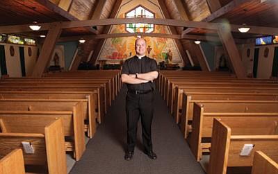 Father Kilian McCaffrey stands inside St. Joseph Parish in Williams. McCaffrey began his duties at the church July 1. Ryan Williams/WGCN