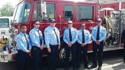 From left: Williams firefighters Juan Cruz, Robert Ortiz, Jeff Pettit, Chase Pearson, Sam Espinoza and Ryan Kopicky stand in front of the Williams Fire Department truck they drove to a memorial service July 9 in Prescott Valley honoring the 19 Granite Mountain Hotshots who died fighting the Yarnell Hill Fire June 30. Submitted photo