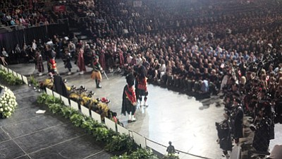 Bagpipers salute the fallen Granite Mountain Hotshots near the end of the July 9 memorial service at Tim's Toyota Center. Photo/Sam Espinoza