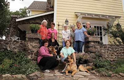 Top row from left: Peggy Thomas, Lupe Miranda-Sapp, Pam Dreher, Carma Lee and Ringo Ashburn, Bottom row from left: Kerry-Lynn Moede and her dog Fritzy, Tracey Cerami and her dog Dude and Pat Anthony and her dog Roxy. Misha the dog is a little camera shy. The group is organizing a house tour set for Aug. 3 in Williams. Ryan Williams/WGCN