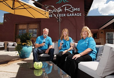 From left: Dan Watt, Kathi Tanamachi and Linda Watt ,owners of South Rims Wine and Beer Garage, enjoy some of the wine their new lounge feature on tap. Ryan Williams/WGCN
