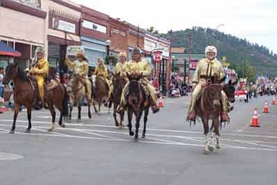 The Bill Williams Mountain Men ride in last year's Labor Day Parade in Williams. This year's parade begins at 11 a.m. on Saturday. Photo/WGCN