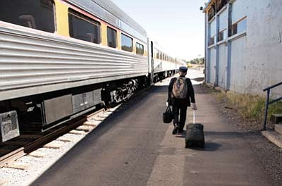 Grand Canyon Railway train conductor Bernie Hiemenz prepares to board a passengerless train headed to the South Rim to collect passengers still at the Canyon. Ryan Williams/WGCN