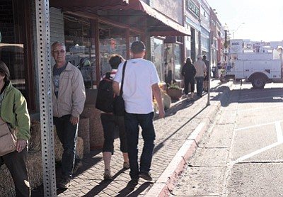 Tourists walk along Route 66 in downtown Williams last week. While some local businesses reported cancellations after the government shutdown caused the closure of Grand Canyon National Park, others, including Bearizona, saw an immediate uptick in business. Ryan Williams/WGCN