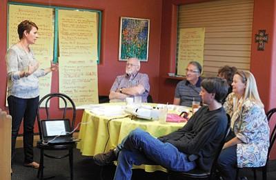 Heather Hermen talks with Williams Chamber members James Wurgler, Doug Wells, Sierra Miller, retreat facilitator Mary Chicoine and Eric Hadder. Photo/Jan Shirley
