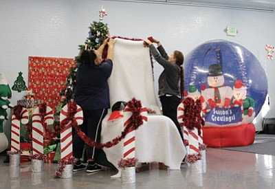 Williams Recreation Center employees Lori Santana and Michelle Walker decorate for the Dec. 14 Santa's World of Wonders event at the Rec Center. Marissa Freireich/WGCN