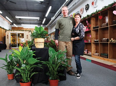 Carl and Mariah Funderburg stand in their recently opened flower and gift shop, The Briar Patch. Ryan Williams/WGCN