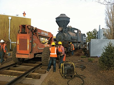 Grand Canyon Railway employees move the Shay locomotive into the display area last week. Photo/Jon Waide