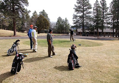 Ken Edes tees off March 5 on the first hole at Elephant Rocks Golf Course in Williams as Denis Kirkley, Rick Shipley and Sam Espinoza look on. Elephant Rocks opened March 4. Ryan Williams/WGCN