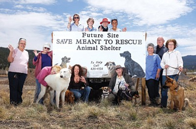 SAVE-Meant to Rescue members gather near the Rodeo Grounds, one of the potential sites for the group's animal shelter.  Preliminary plans for the shelter include eight kennels with attached exercise yards. Ryan Williams/WGCN