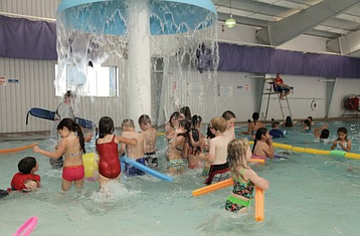 Kids play in the Williams Aquatic Center pool. The pool opens Saturday for the summer season with a free swim and luau party. Ryan Williams/WGCN