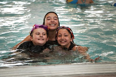 Mary Murders, Jazlyn Romero and Cayla Fritsinger enjoy the pool at the Williams Aquatic Center during a Summer Splash Rec  Program outing last year. Ryan Williams/WGCN
