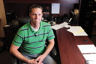 Williams' new Public Works Director Kyle Christiansen takes a break in his office. Christiansen oversees the water, wastewater, sanitation, streets and maintenance departments. Ryan Williams/WGCN