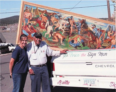 "Monica Glassburn and Fred ""Perico"" Avila ready a painting by Frank Yarbrough and Reynaldo Manrriquez for transport to Flagstaff, Arizona. Submitted photo"