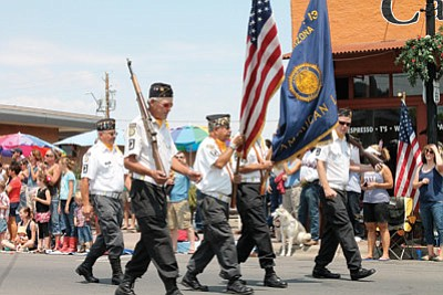 Members of the American Legion Cordova Post No. 13 march in last year's Fourth of July parade down Route 66. Photo/WGCN