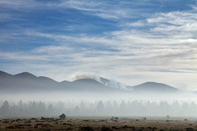 Smoke pours over Sitgraves Mountain, approximately five miles northwest of Parks. Ryan Williams/WGCN