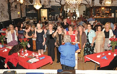 Members of the Matthew J. Broehm VFW Post 12128 Ladies Auxiliary are sworn in Aug. 23 at the Sultana Theater in Williams. Photo/Rodger Ely