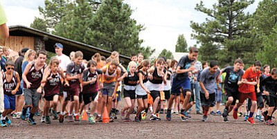Williams Elementary-Middle School runners Dakota Dent (fifth grade), Madison Olson (seventh Grade) and Ashlynn Kennelly (sixth grade),  jump out to a strong start in the first leg of a four-mile cross country relay race Aug. 27 at Buffalo Park in Flagstaff. Ryan Williams/WGCN