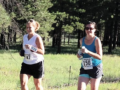 Leah Payne (left) and Gabi Uebel take part in the fourth annual Lions Club Run. Submitted photos
