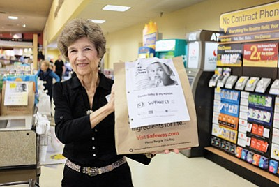 Safeway employee Julie Pritchard displays the pre-assembled bags that people can purchase at the store and then donate to the Williams Food Bank. Ryan Williams/WGCN