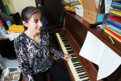 Williams Unified School District music teacher Beverly Stearns takes a break at the piano in her office. Stearns is hoping to revive the district's music program by challenging her students. Ryan Williams/WGCN