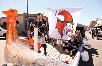 Williams High School students ride a Vikings float through downtown Williams during last year's homecoming parade. Ryan Williams/WGCN