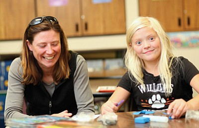Liz Lane (left) and Ashley Alexander spend some time together with crafts during School Based Mentoring time at Williams Elementary-Middle School. The Big Brother Big Sister program meets on Thursdays at the school. Ryan Williams/WGCN