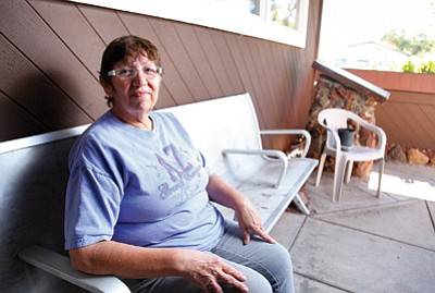 Williams Senior Center Director Dolores Paredes takes a rare break outside the center's front door. Paredes stepped in as director after Max Bishop retired in September. Ryan Williams/WGCN