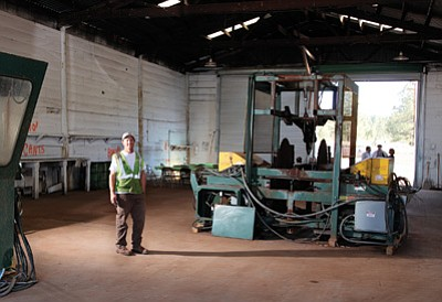 Newpac Fibre CEO Chris Stephan stands next to milling equipment the company recently purchased that used to run at a mill in Ash Fork between 2007 and 2009. Ryan Williams/WGCN