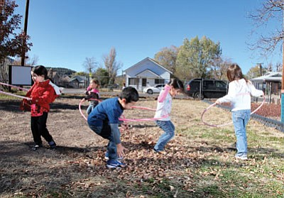 Above and below: Williams Head Start students spend time playing outside to develop their motor skills. The Williams program is currently trying to fill three open spots in its afternoon program. Ryan Williams/WGCN