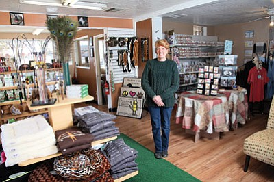 Traci Fulkerson stands in Spoiled Rotten Pet Boutique and Supplies. Fulkerson and Dr. Daniel Jacoby opened the store Nov. 1. Ryan Williams/WGCN