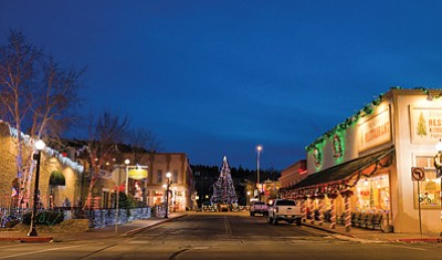 Businesses participating in last year's lighting contest illuminate Second Street with their entries. The deadline to apply for this year's lighting contest is Nov. 26. Ryan Williams/WGCN