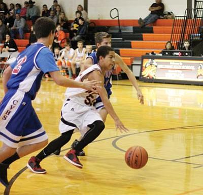 Williams Viking Reggie Reed drives to the basket during the junior varsity team's season opener against Camp Verde at home on Nov. 25. Marissa Freireich/WGCN