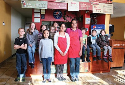 Big Town Hero owners Shital and Nimo Patel, center, congratulate recent Williams Elementary-Middle School Students of the Month. The Patels reward Students of the Month with a free sandwich coupon. The students are: (from left) Gabriel Lowe, Allyson Stearns, Audrey Stearns, Christine Salgado, Ethan Jenks, Ivan Duran, Jenna Wouters, Jose Mercado and Erin Lucas. Ryan Williams/WGCN.