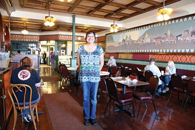 Grand Canyon Coffee and Café owner Anna Dick stands in the dining room at the restaurant's new location in the Red Garter Bed and Bakery in downtown Williams. Ryan Williams/WGCN