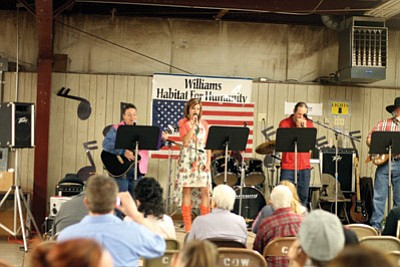 Williams Opry Band members Debi Campbell, Katie Wamble and Patrick O'Brien entertain the crowd at Grand Opry Night in the Rodeo Barn. The semiannual event, put on by Williams Habitat for Humanity, will feature a cakewalk, food, drink and dancing. Submitted photo