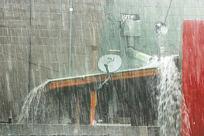 File photo of torrential monsoon rain drenching Williams in 2012.<br /><br /><!-- 1upcrlf2 -->
