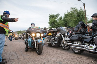 Run for the Wall riders find parking spots in front of the American Legion in Williams. Ryan Williams/WGCN