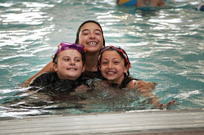 Mary Murders, Jazlyn Romero and Cayla Fritsinger enjoy the pool at the Williams Aquatic Center during a Summer Splash Rec Program outing. Ryan Williams/WGCN