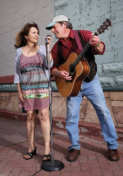 Lu and John Carpino sing on Route 66 in downtown Williams. The John Carpino Band takes the stage Saturday to close out the Wild West Weekend party. Ryan Williams/WGCN
