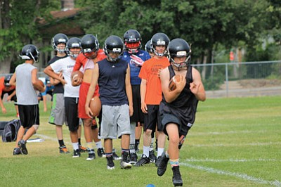 Tate Grantham leads an offensive drill during preseason football practice at Williams High School. Wendy Howell/WGCN