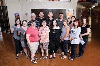 Pictured: Clint Keller, Michael Lee, Rick Honsinger, Joshua Bukowiecki, Megan Courtney, Linda Honsinger, Sharon Potter, Kim Dodds, Trish Smith, Jackie Carlile, Heather Windham, Kellie O'Toole-Lee, and Carissa Morrison. Missing is James Powers. Ryan Williams/WGCN