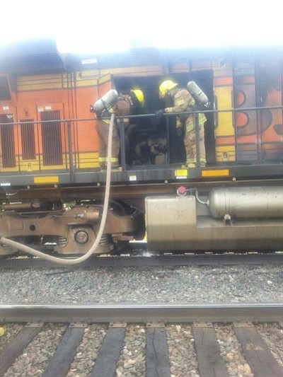 Williams firefighters and railway crews put out an engine fire on a BNSF locomotive Aug. 22. Photo/Williams Fire Department